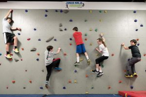 kids climbing wall and obstacle course training at ultimate ninjas in Chicago