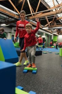 Kids camp and kids open play on authentic american ninja warrior courses